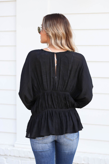 Model wearing Black Long Sleeve Ruched Blouse Back View