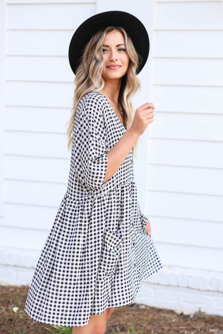 Model wearing Black and White Gingham Babydoll Dress Side View