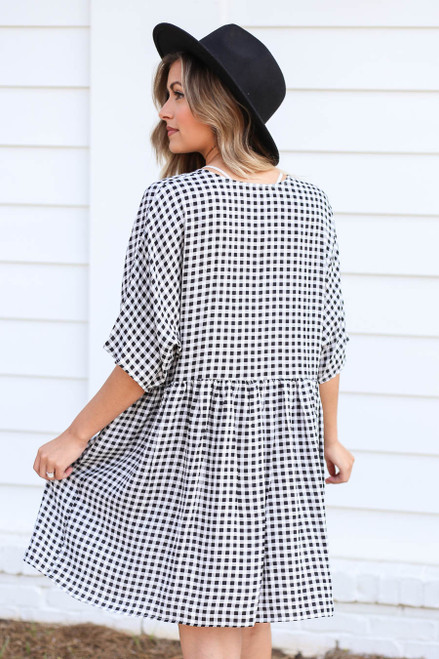 Model wearing Black and White Gingham Babydoll Dress Back View