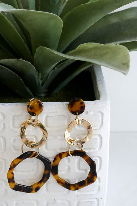 Black - Tortoise Statement Earrings Hanging on Vase