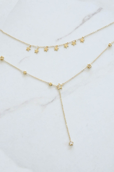 Gold - Layered Star Charm Necklace Flat Lay
