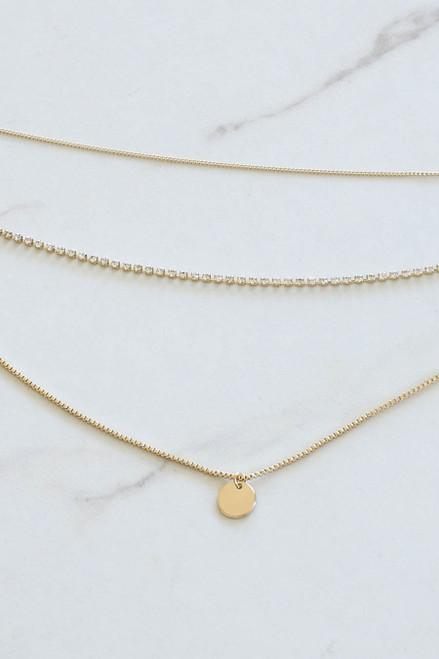Flat Lay of Gold Tri Layer Necklace