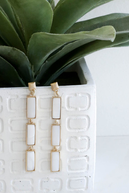 White - Stone Drop Earrings Hanging on Vase