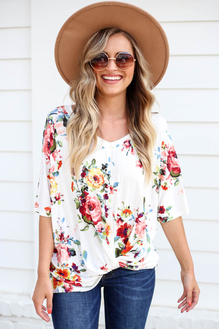 Model wearing Ivory Floral Twist Front Top