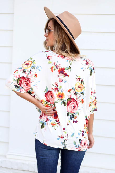 Model wearing Ivory Floral Twist Front Top Back View