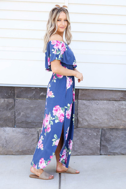 Model wearing Navy Floral Off the Shoulder Maxi Dress Side View