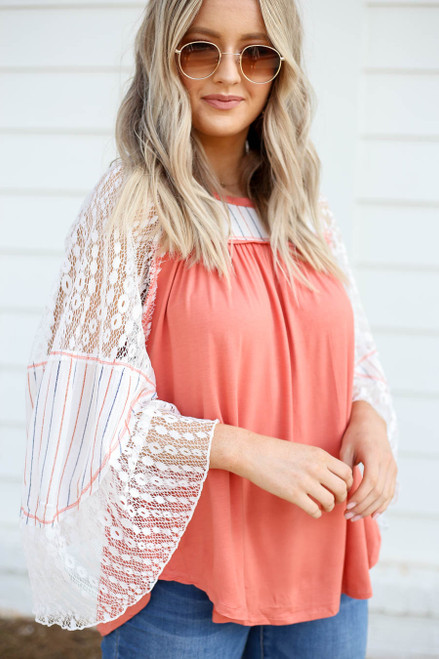 Model wearing Coral Lace Flutter Sleeve Top Detail View