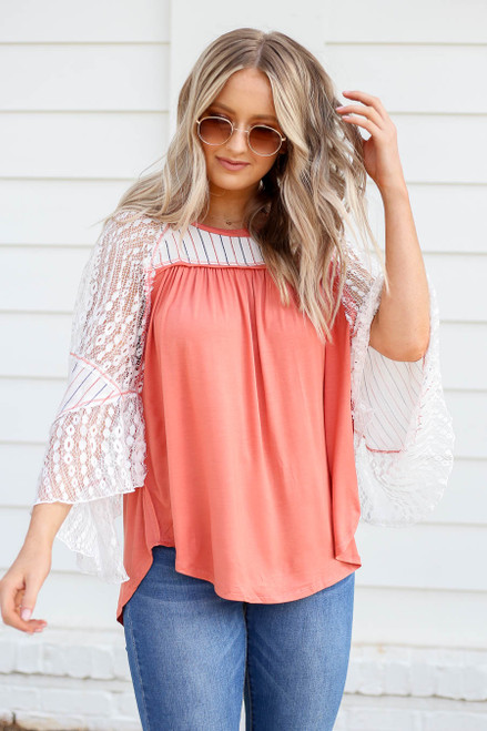 Model wearing Coral Lace Flutter Sleeve Top Front View