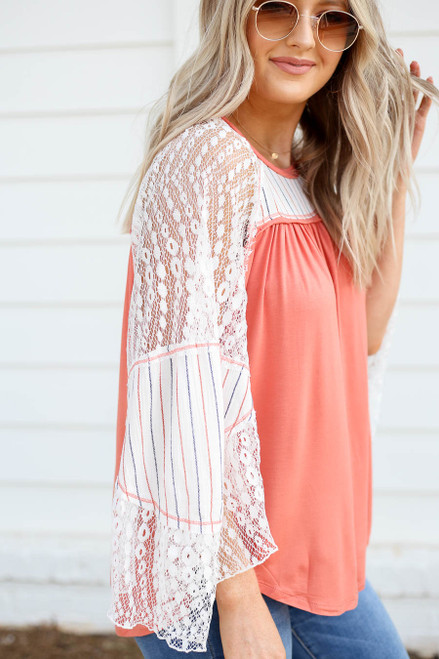 Model wearing Coral Lace Flutter Sleeve Top Side View