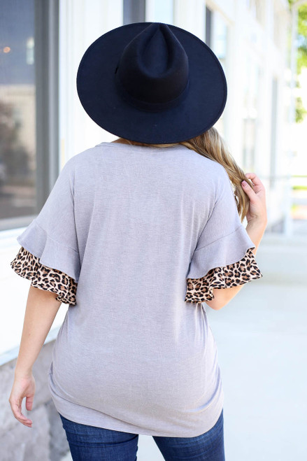 Model wearing Grey Ruffle Sleeve Top with Leopard Trim Back View