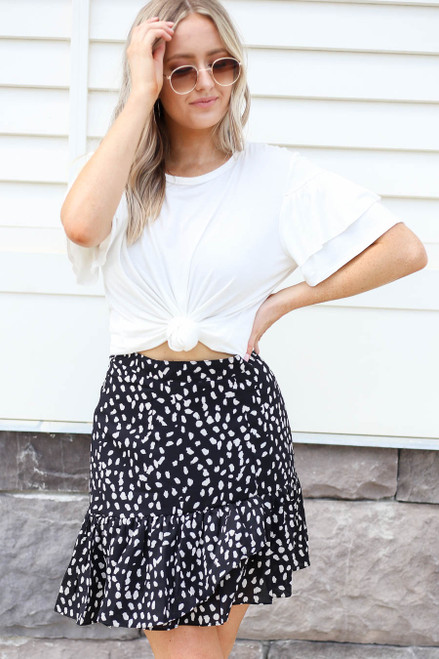 Model wearing Black Spotted Ruffle Skirt Front View