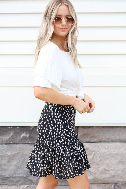 Model wearing Black Spotted Ruffle Skirt Side View