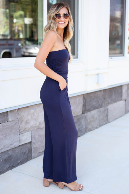 Model wearing Navy Basic Strapless Jumpsuit Side View