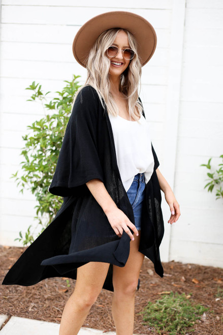 Model wearing Black Oversized Slit Cardigan