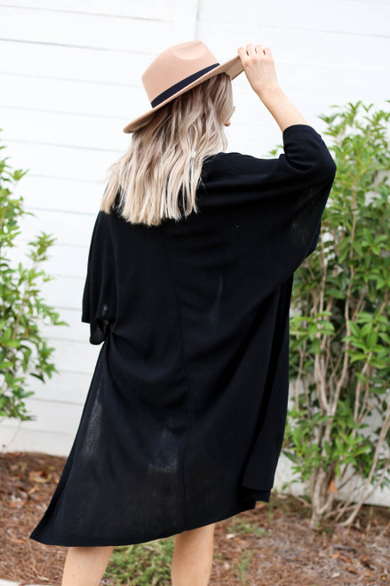 Model wearing Black Oversized Slit Cardigan Back View