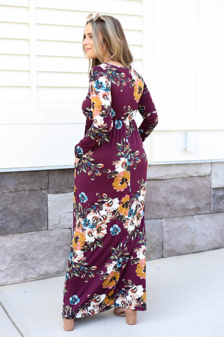 Model wearing Burgundy Long Sleeve Floral Maxi Dress Back View