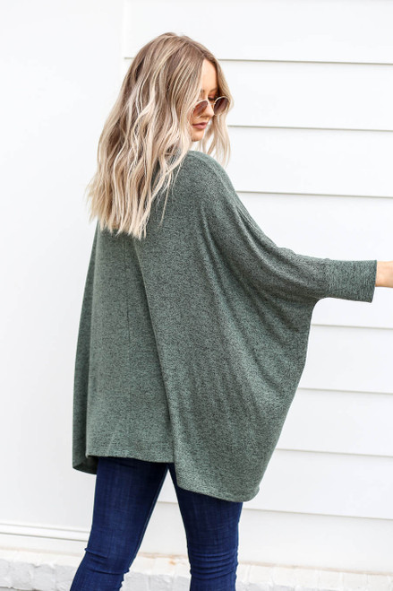 Model wearing Olive Oversized Knit Top Back View