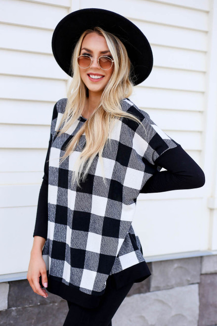 Model wearing White and Black Buffalo Plaid Top