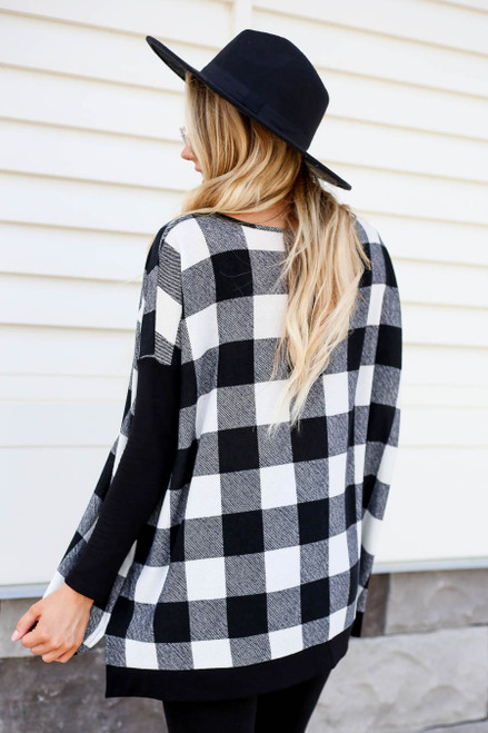 Model wearing White and Black Buffalo Plaid Top Back View