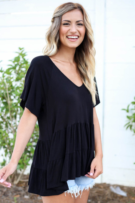 Black - Model wearing Black Oversized Tiered Top