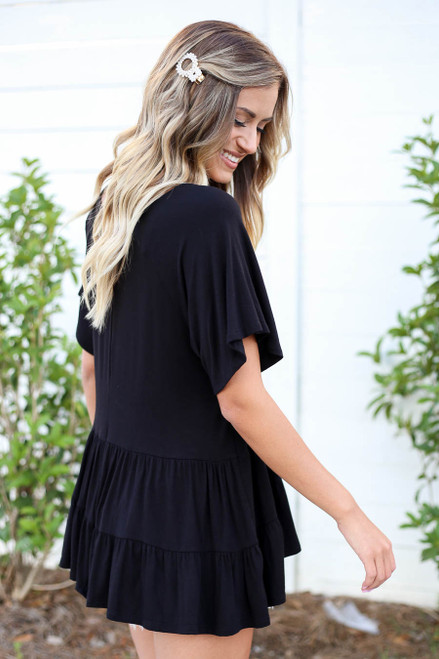 Model wearing Black Oversized Tiered Top Back View