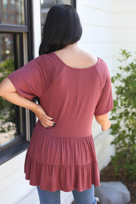 Model wearing Marsala Oversized Tiered Top Back View