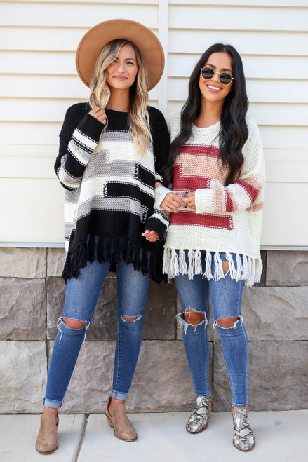Model wearing Black and Ivory Fringe Chunky Knit Sweaters