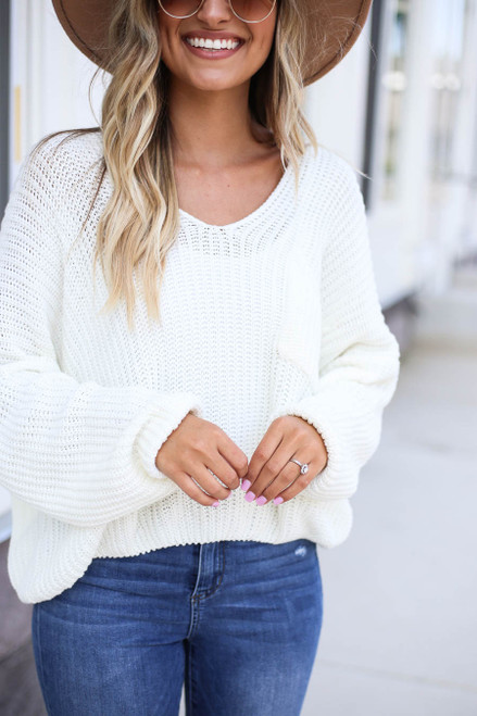 Model wearing Ivory V-Neck Cropped Sweater Detail View