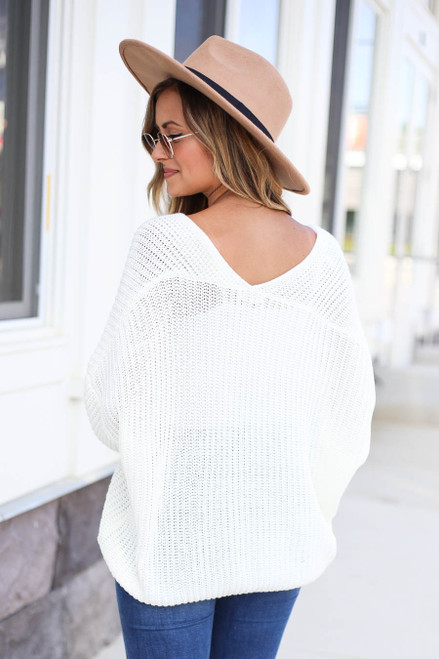 Model wearing Ivory V-Neck Cropped Sweater Back View