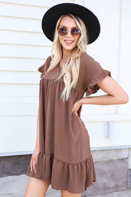 Model wearing Mocha Ruffle Babydoll Dress Side View