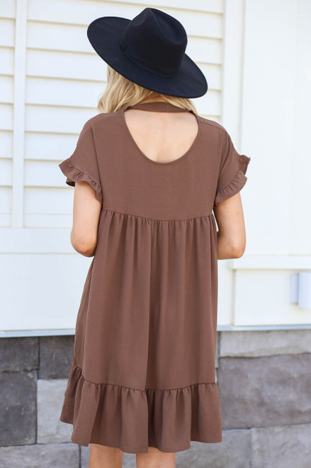 Model wearing Mocha Ruffle Babydoll Dress Back View