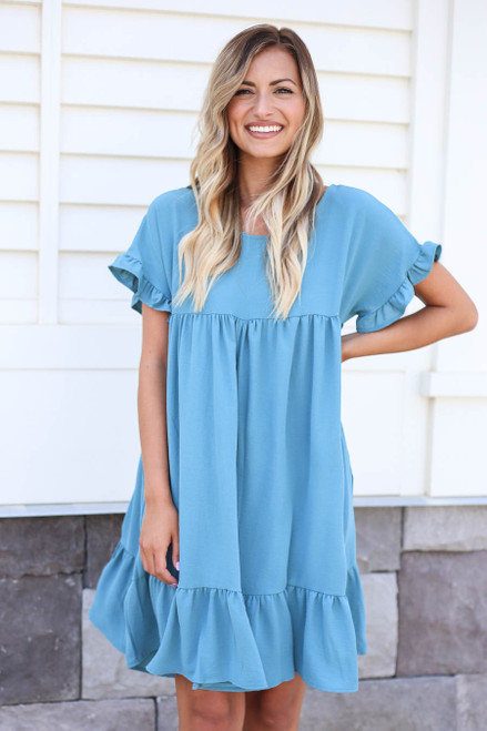 Model wearing Teal Ruffle Babydoll Dress Front View