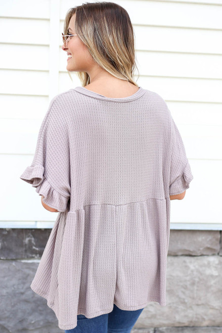 Model wearing Taupe Waffle Knit Babydoll Top Back View