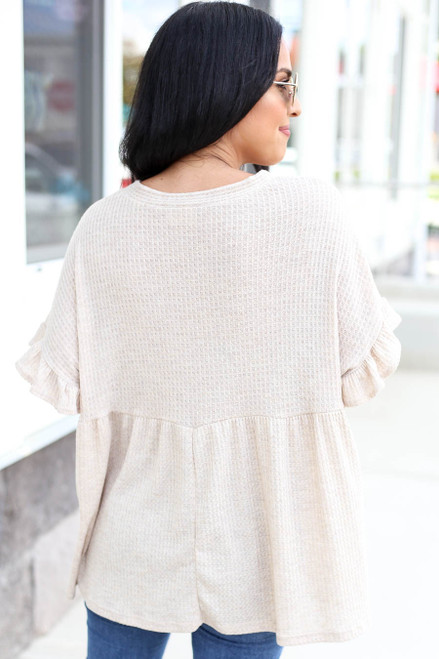 Model wearing Ivory Waffle Knit Babydoll Top Back View