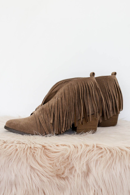 Flat Lay of Taupe V-Cut Fringe Booties