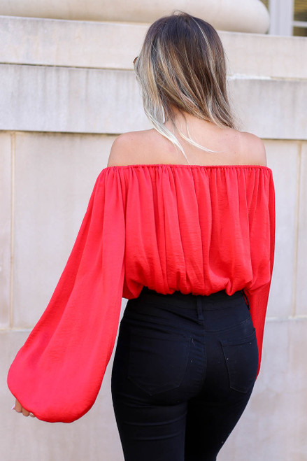 Model wearing Red Off the Shoulder Balloon Sleeve Blouse Back View