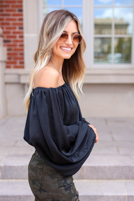 Model wearing Black Off the Shoulder Balloon Sleeve Blouse Side View