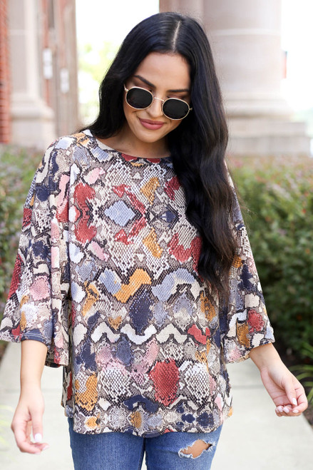 Model wearing Mauve Snakeskin Blouse Front View
