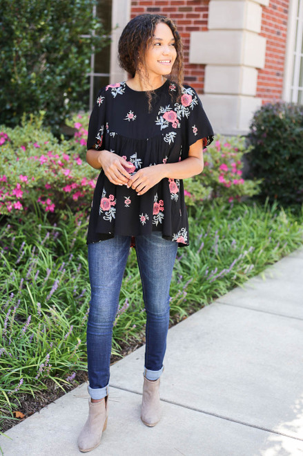 Model wearing Black Floral Embroidered Babydoll Top