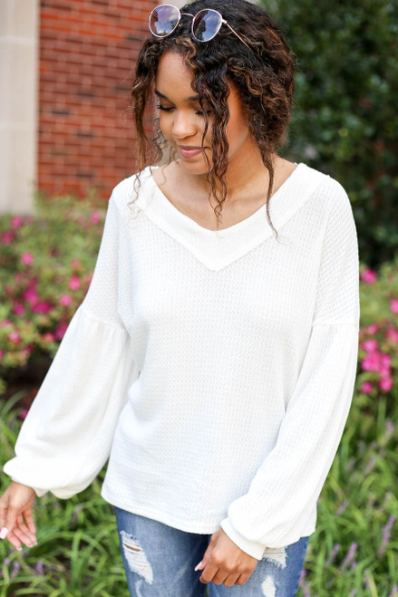 Model wearing White Balloon Sleeve Waffle Knit Top