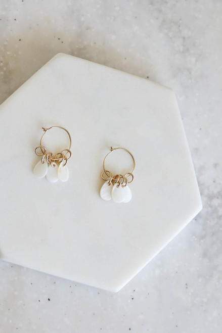 White Stone Accent Earrings Flat Lay