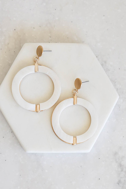 White Round Statement Earrings Flat Lay