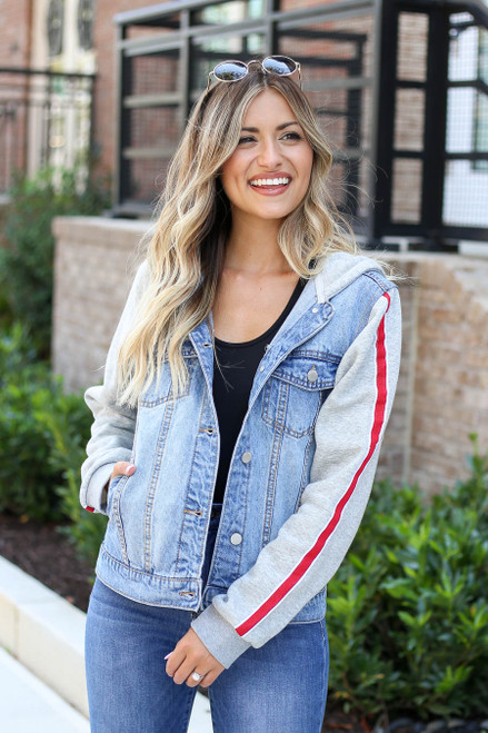 Model wearing Light Wash Denim Vested Hoodie with Side Stripe