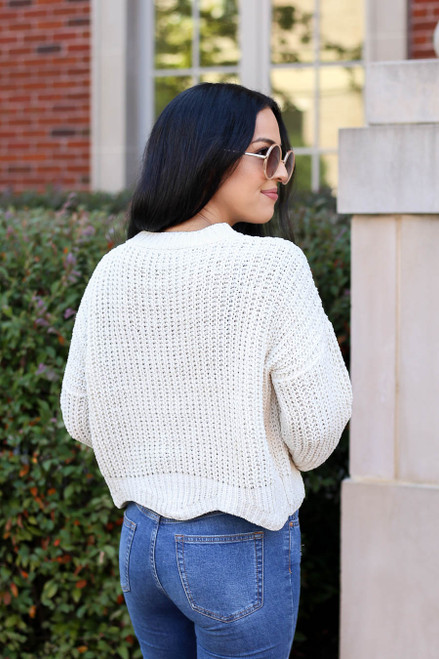 Model wearing Ivory Scalloped Chunky Knit Cropped Sweater Back View