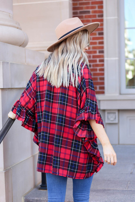 Model wearing Red Oversized Plaid Ruffle Sleeve Top Back View