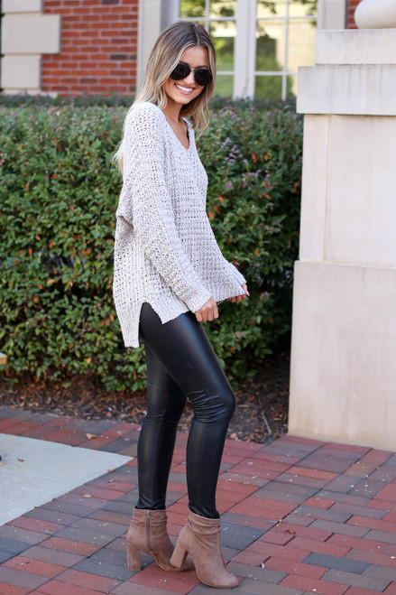 Model wearing Black Super High Rise Faux Leather Leggings Side View