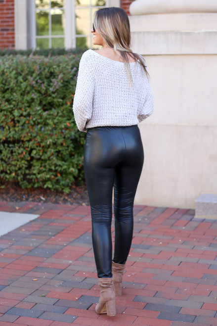 Model wearing Black Super High Rise Faux Leather Leggings Back View