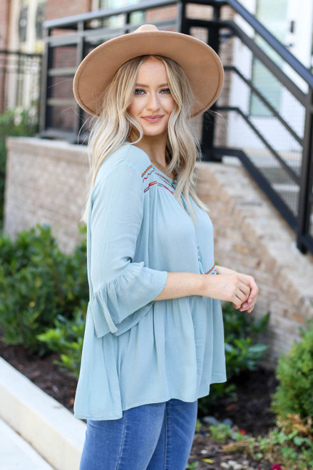 Model wearing Mint Embroidered Babydoll Blouse