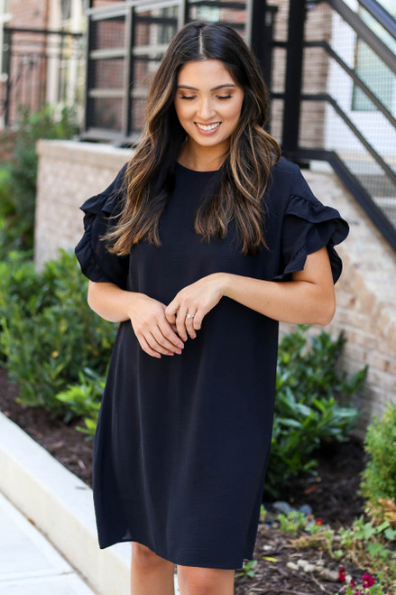 Model wearing Black Ruffle Sleeve Dress