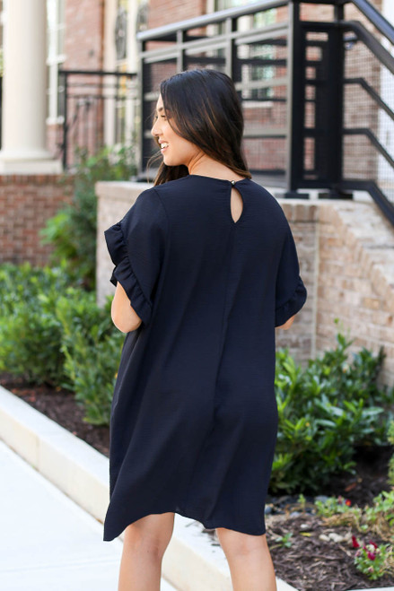 Model wearing Black Ruffle Sleeve Dress Back View